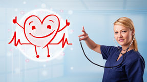 Attractive doctor with happy red smiling heart Stock Photography