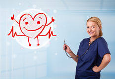 Attractive doctor with happy red smiling heart Royalty Free Stock Photo