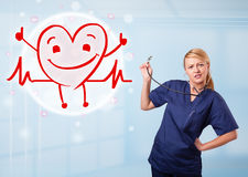 Attractive doctor with happy red smiling heart Royalty Free Stock Photos