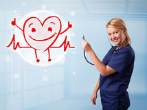 Attractive doctor with happy red smiling heart Royalty Free Stock Images