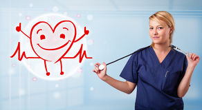 Attractive doctor with happy red smiling heart Royalty Free Stock Photography