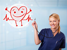 Attractive doctor with happy red smiling heart Royalty Free Stock Image