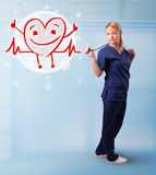 Attractive doctor with happy red smiling heart Stock Photos