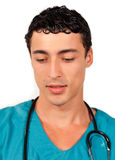 Attractive doctor holding a stethoscope Stock Photos
