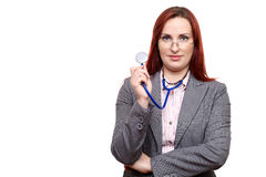 Attractive doctor or physician looking over glasses Royalty Free Stock Photography