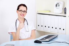 Attractive doctor showing okay gesture. Stock Photography
