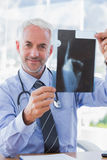 Attractive doctor showing a radiography Stock Images