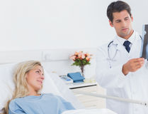 Attractive doctor showing xray Stock Image