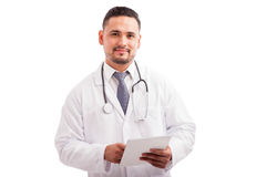Attractive doctor with a tablet computer Royalty Free Stock Photos