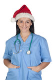 Attractive doctor woman with Christmas cup Stock Image