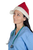 Attractive doctor woman with Christmas cup thinkin Royalty Free Stock Photo