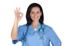 Attractive doctor woman saying OK Royalty Free Stock Images