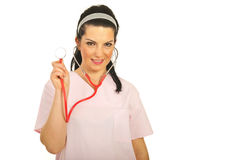 Attractive doctor woman showing stethoscope Stock Photo