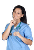 Attractive doctor woman thinking Royalty Free Stock Photography