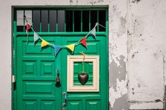 Attractive double green door stock photography