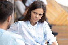 Attractive doubting woman looking at man in cafe close up. Attractive young doubting women looking at men in cafe close up, bad first impression, new stock images