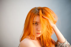 Attractive dreammy portrait of redhead woman in soft focus Stock Photos