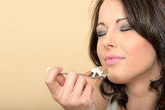 Attractive Dreamy Young Woman Eating a Chocolate Mousse Dessert Stock Photography