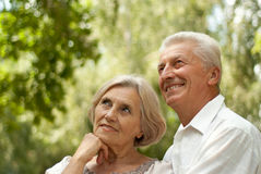 Attractive elderly couple went in the park stock photography