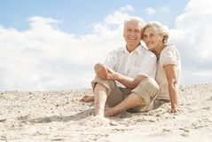 Attractive elderly people enjoy the sea breeze Royalty Free Stock Image