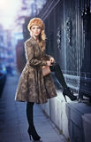 Attractive elegant blonde young woman wearing an outfit with Russian influence in urban fashion shot. Beautiful fashionable girl Stock Photography