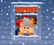 Attractive elegant couple drinking wine. Beautiful man and woman talking near winter window. Royalty Free Stock Images