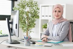Attractive female muslim business office worker
