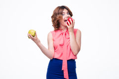 Attractive elegant woman eating apple Stock Photos