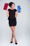 Attractive elegant woman holding two gift boxes Stock Photography