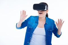 Attractive emotional woman experiencing 3d reality. 3d dimension. Attractive emotional nice woman smiling and feeling excited while experiencing 3d reality Stock Images