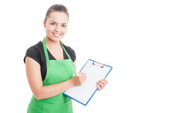 Attractive employee working in supermarket and holding clipboard Stock Image