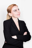 Attractive and energetic business woma in a suit on naked body Royalty Free Stock Photography