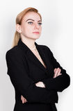 Attractive and energetic business woma in a suit on naked body Royalty Free Stock Photos