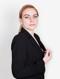 Attractive and energetic business woma in a suit on naked body smiling Royalty Free Stock Photo