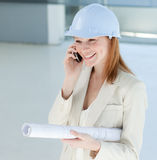 Attractive engineer on phone Stock Image