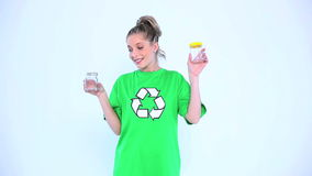 Attractive environmental activist holding two bottles stock footage