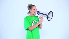 Attractive environmental activist screaming in a megaphone stock footage