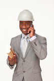 Attractive ethnic architect on phone Royalty Free Stock Photo