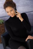 Attractive ethnic businesswoman on mobile Stock Images