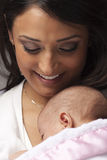 Attractive Ethnic Woman with Her Newborn Baby Stock Image