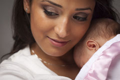 Attractive Ethnic Woman with Her Newborn Baby Royalty Free Stock Photos