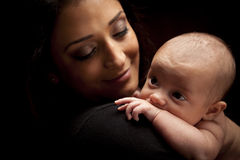 Attractive Ethnic Woman with Her Newborn Baby stock photo