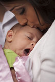 Attractive Ethnic Woman with Her Yawning Newborn Baby Royalty Free Stock Photography