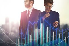 Technology, communication and stock concept. Attractive european businessmen using smartphone on abstract blurry city background with forex chart. Technology stock images