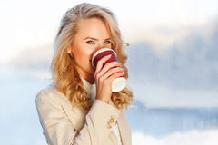 Attractive european woman drinking coffee relaxing in break at work Stock Photography