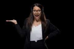 Attractive excited businesswoman presenting something Stock Photos