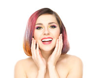 Attractive excited girl with colorful make-up on isolated background Stock Image