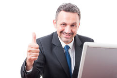 Attractive executive manager showing thumb up Stock Photo