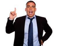 Attractive executive speaking and pointing up Stock Photo