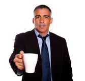 Attractive executive with a white mug Stock Photos